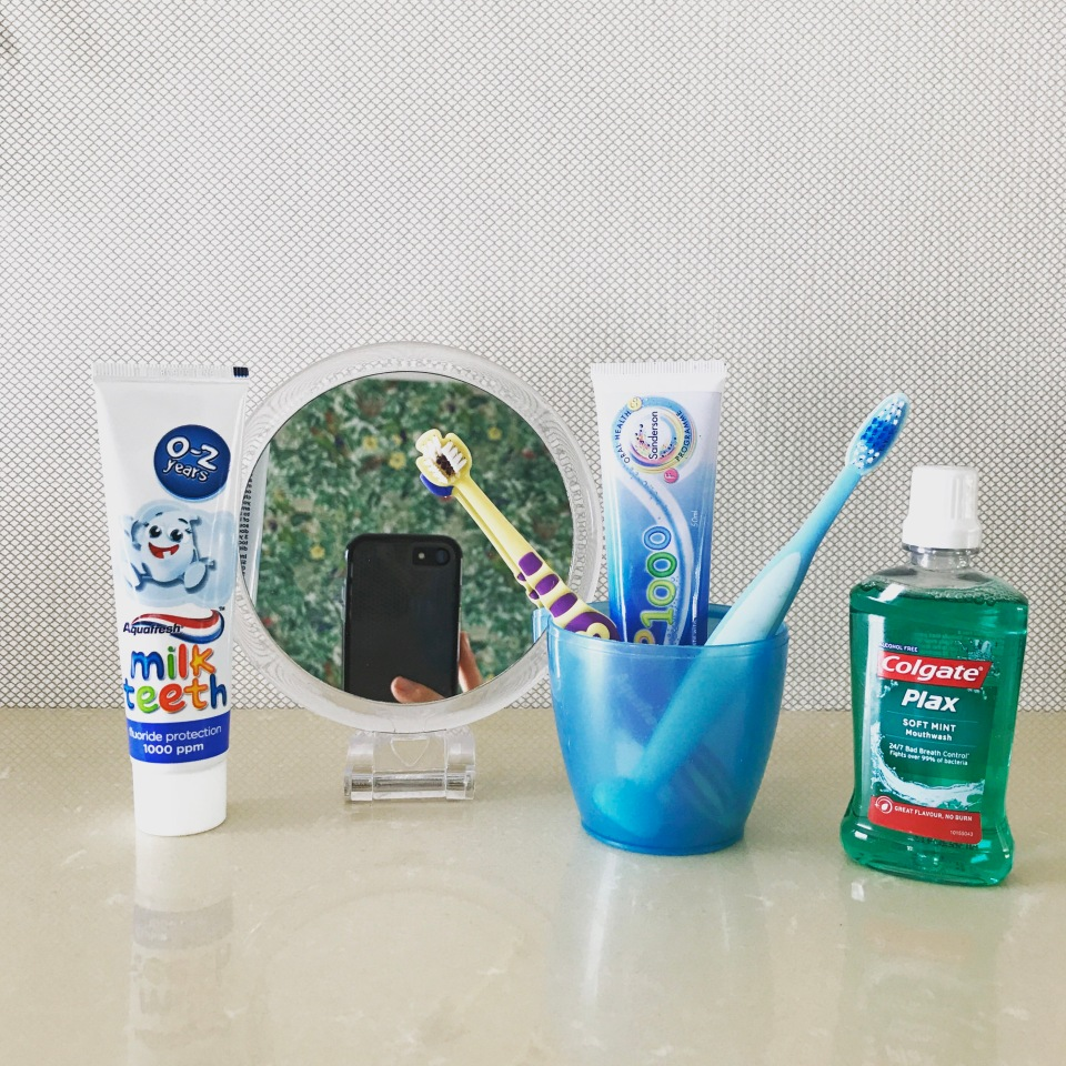 Treasure basket about cleaning teeth to help a baby get used to the idea